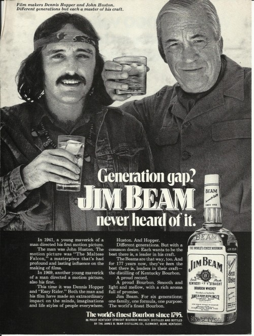 Dennis Hopper and John Huston, advertisement for Jim Beam, 1972 Source: Aphelis See some classic Dennis Hopper photographs at Boom Underground, who is posting them as part of a month-long series on Hunks We Were Hot For, a look at male heart-throbs from the 1960s & 70s (and a few from the 50s!).