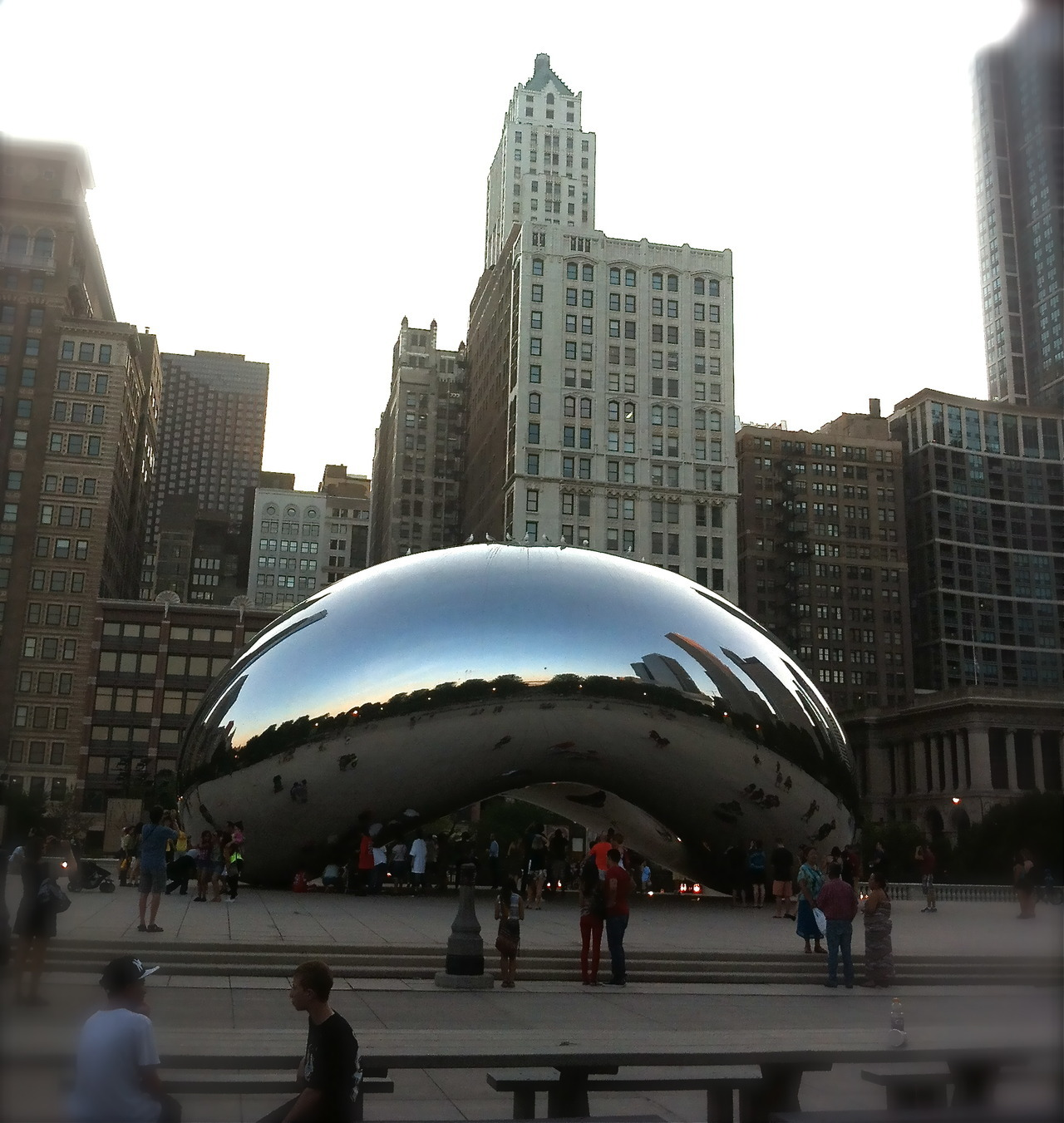 "Cloud Gate by Indian-born British artist Anish Kapoor. Constructed between 2004 and 2006, the sculpture is nicknamed ""The Bean"" because of its bean-like shape. Made up of 168 stainless steel plates welded together, its highly polished exterior has no visible seams. It is 33 by 66 by 42 feet (10 by 20 by 13 m), and weighs 110 short tons (100 t; 98 long tons)."