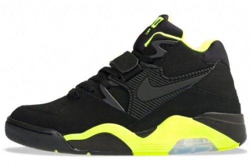 "Nike Air Force 180 - Black/Black Volt Following the release of the Nike Air Force 180 ""Olympic"", they're about to drop in a black/black volt colourway. Made up of a pylon midsole with Max Air on the heel and a velcro strap on the midfoot. The bolt around the lining, midsole and outsole gives this shoe some vibrancy whilst the rest is completely black."