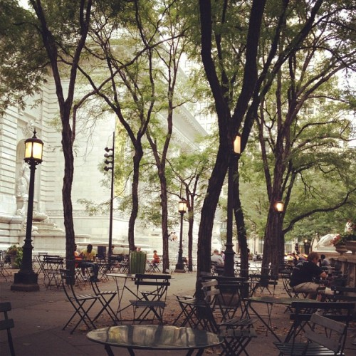 Reading outside the NY Public Library in this perfect Saturday weather… (Taken with Instagram)