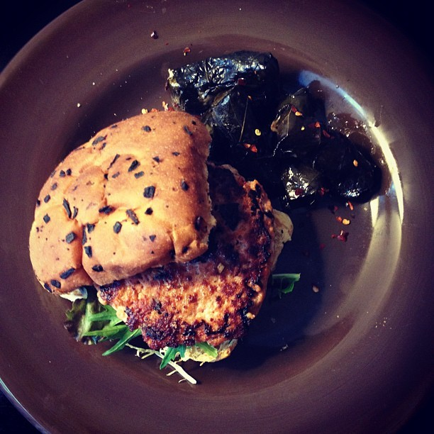 Mediterranean salmon burger. Rosemary mustard, on an onion roll. Dolmades. (Taken with Instagram at The 503 Kitchen)