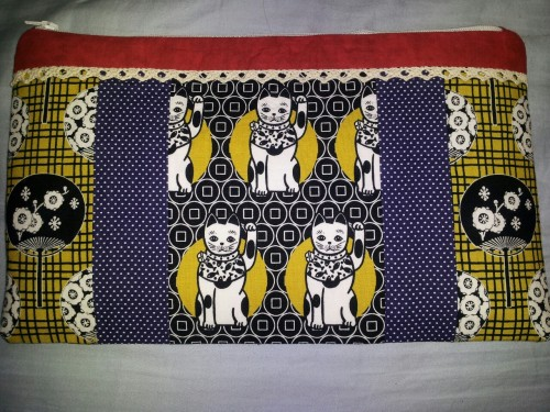 youcraftyjackrabbit:  grandmaprints:  I made an adorable clutch!  couldn't wait for the queue, super proud of this!  (it needs a zipper-pull, but I was too lazy to look through my jewelry stuff)  Kaitlin, I LOVE it!
