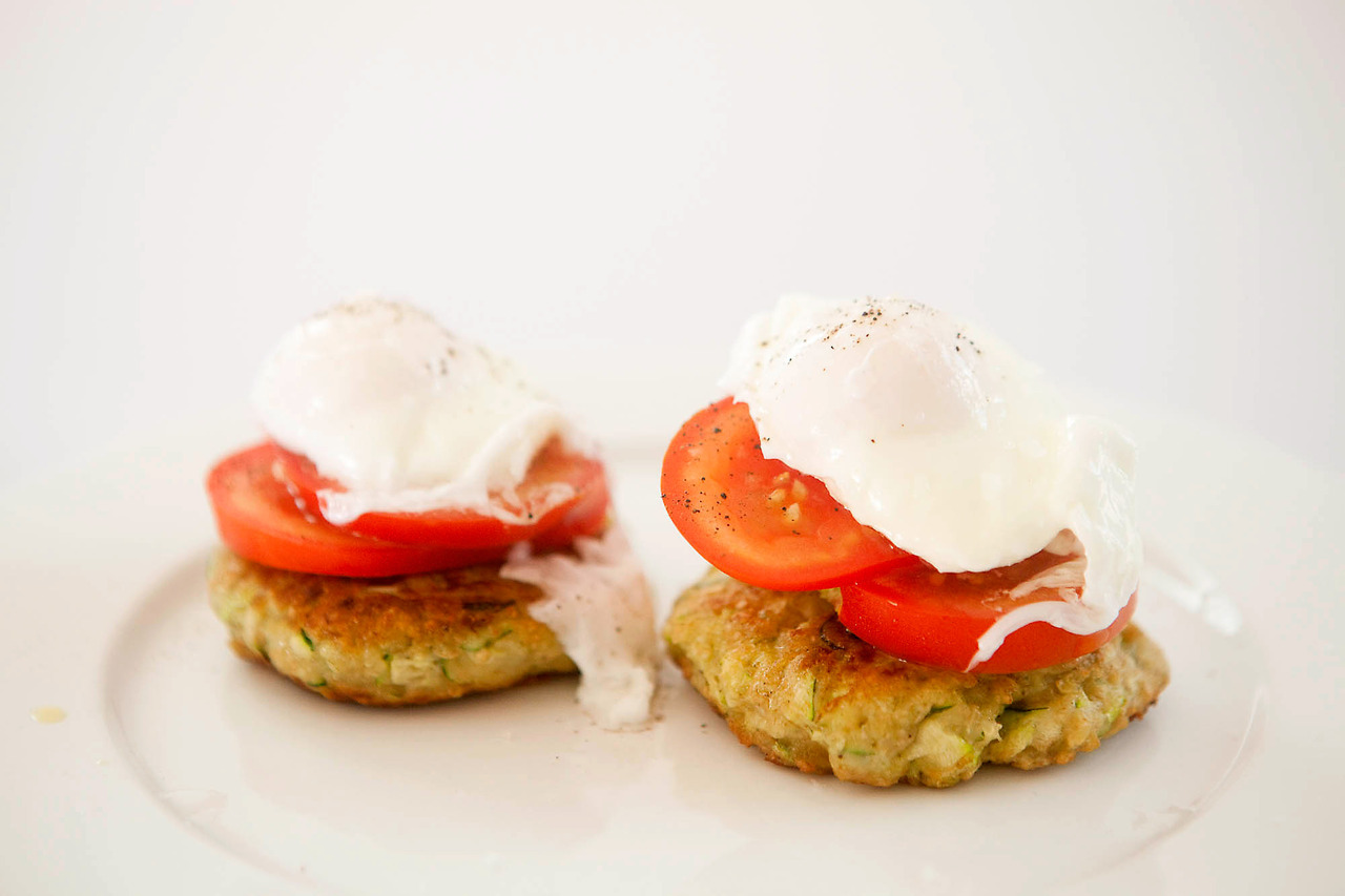 Zucchini Fritters with Poached Eggs and Tomato The lemon zest in this is really citrusy and flavorful, but I prefer big flavors and without it it would have been too bland.  Press as much water out of the zucchini as you can and use the wet and dry ingredients to get the right texture so it sticks together and forms patties. Ingredients: 1 zucchini, grated and water pressed out Zest of 1 lemon 3/4 cup grated parmesan cheese 1 egg 1/4 cup wheat flour Salt and pepper Olive oil for frying Mix the ingredients; the mixture should be fairly dry but stay together.  Fry for 3-4 minutes on each side until golden. Serve with fresh tomato and poached eggs.