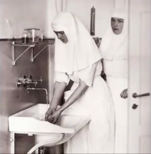Grand Duchesses Olga and Tatiana as nurses, c. 1915