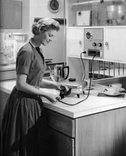 dtxmcclain:  The 1950s housewife, getting ready to prepare a meal with her modern electric appliances.