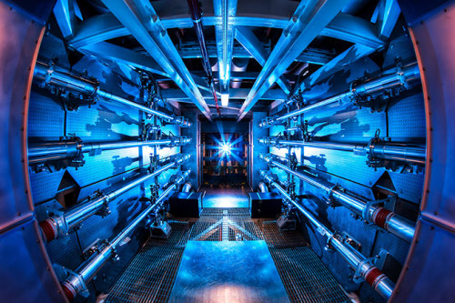 "quantumaniac:  Record-Breaking Laser Hits 500 Trillion Watts Laser physicists at the Lawrence Livermore National Laboratory have broken the record for the highest-power laser shot with a collection of beams delivering more than 500 trillion watts of peak power. The National Ignition Facility fired 192 beams at the same time, delivering 1.85 megajoules of ultraviolet laser light to a target a mere two millimeters in diameter. To put those numbers into perspective, the 500 terawatt figure is 12,500 times greater than the demand for electricity in 2006 in Britain, which averaged out at 40 gigawatts. ""For scientists across the nation and the world who, like ourselves, are actively pursuing fundamental science under extreme conditions and the goal of laboratory fusion ignition, this is a remarkable and exciting achievement,"" said Richard Petrasso, senior research scientist and division head of high energy density physics at the Massachusetts Institute of Technology in a press release. ""The 500 TW shot is an extraordinary accomplishment by the NIF Team, creating unprecedented conditions in the laboratory that hitherto only existed deep in stellar interiors,"" The National Ignition Facility is the world's foremost laser research establishment, producing lasers than can regularly carry more than 100 times the energy of any other laser. The 500 terawatt firing hits a milestone set in the late 90s when the facility was being planned, and takes researchers a step closer to the goal of igniting hydrogen fusion. ""NIF is becoming everything scientists planned when it was conceived over two decades ago,"" NIF director Edward Moses said in the release. ""It is fully operational, and scientists are taking important steps toward achieving ignition and providing experimental access to user communities for national security, basic science and the quest for clean fusion energy."""
