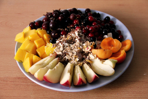 gaintheirjealousy:  Fruity breakfast with yoghurt; topped with flax and muesli, mango and nectarine, apricots and berries