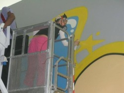Giant graffiti wall art painting by Sya & Bow at the Aloft Hotel in Abu Dhabi. July 2012.