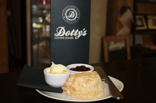 freshly baked scone with clotted cream and jam