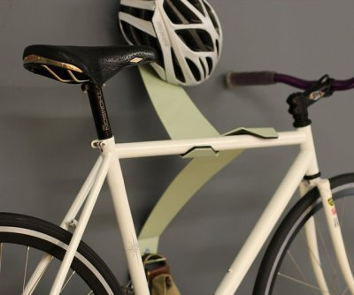 I prefer the lower profile wooden art hangers for bikes but what I like about this is the helmet and bag hook. It looks really cool!