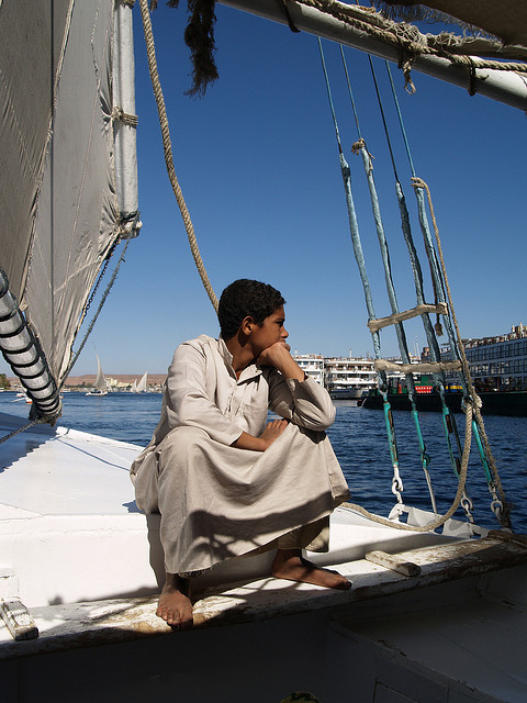 boltonsimon:  Boy on a falucca at Aswan Egypt on Flickr.