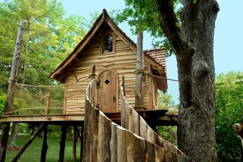 "Field Excursions: Cheekwood treehouse exhibit brings literature to life  ""A treehouse, a free house, a secret you and me house …"" wrote the famed poet of childhood Shel Silverstein. For those lucky enough to have spent childhood playing in a treehouse or fort, the memories reveal the value of these secret hideaways in children's lives. For those who weren't fortunate enough to have a treehouse escape, here's your chance: Cheekwood Botanical Garden and Museum of Art in Nashville invites you to explore and enjoy seven whimsical treehouses as part of their annual summertime family exhibit. Treehouses: Great Works of Literature features large-scale outdoor treehouse structures inspired by great works of literature throughout the ages. ""These treehouses are more than you would imagine a treehouse could be,"" Leigh Anne Lomax, Cheekwood Botanical Garden horticulture manager, said. ""Each one is interactive, very well thought out and brings literature to life."" …  nooga.com Photo: Cheekwood Botanical Garden and Museum of Art"