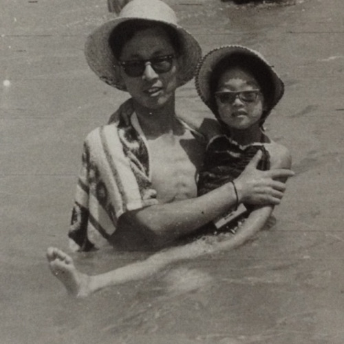 Mom with grandfather at the beach.