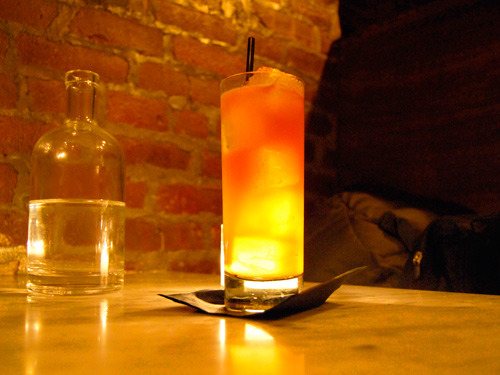 Mexican Firing Squad - blanco tequila, grenadine, lime, bitters, soda. Figured out a delicious way to use up that bottle of grenadine.