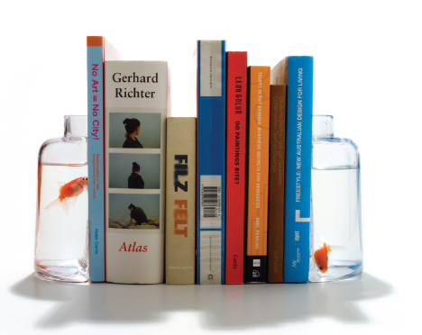 explore-blog:  Halve Bookends, made of two split halves of a glass jar and fillable with anything you like.   I love good/fun design!