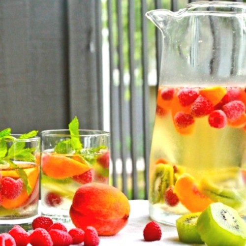 conflictingheart:  White wine sangria with peaches and kiwi.