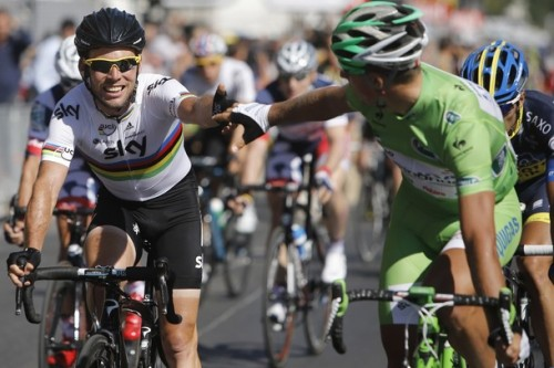 Stage winner Mark Cavendish of Britain, left, is congratulated by Peter Sagan of Slovakia, wearing the best sprinter's green jersey, after the last stage of the the Tour de France cycling race in Paris, France, Sunday July 22, 2012. (via Photo from AP Photo)