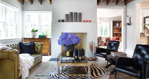"What a darling room!  Elegant, yet ""homey.""  Exposed beams, a large vase of purple hydrangeas and a zebra rug.  Who wouldn't want to come home to a zebra rug?!"
