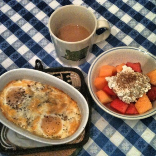 Baked Eggs with Cheese and Herbs This really is the easiest breakfast. Just preheat your oven or toaster oven to 350 degrees. Crack two eggs in a greased oven safe dish. I use spray olive oil. Sprinkle the eggs with grated cheese, herbs/spices, sea salt and ground pepper. My favorite herbs and spices for eggs are:  garlic, dill, parsley, red pepper and sometimes basil. Sometimes I add whatever chopped veggies I have on hand. Then I just pop it in the oven for 10 min. I like the yolks to be soft. If you want them firmer just bake a few minutes. Remove and let the eggs sit for a few minutes as they will continue to cook a little bit. While the eggs are cooking I usually make some gluten free toast or fresh fruit. This time I had watermelon, cantaloupe, low fat cottage cheese and cinnamon. And coffee too! I hope you try this easy, healthy and protein packed breakfast. -the gluten free artist