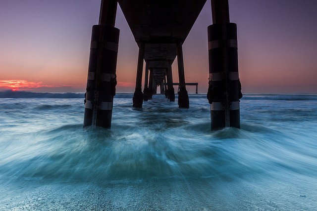 "Getting Wet Under The Pier on Flickr.Via Flickr: I am honored to have done an interview and be the featured photographer on TIA International Photography's Blog today. Being a night shooter, I found a lot of Tosin's work very intriguing and inspiring. Tosin is the owner and photographer of TIA. After a few exchanges over facebook I ended up doing an interview for his blog. It will be the first interview I have done on my photography, so it was interesting to talk about my photos and experiences. Tosin, who I actually met up with a month back in San Francisco to go shoot, when he visited, is one of the nicest guys and an awesome photographer.  It was a pleasure, only though we got fogged in on our shoot. I am humbled about all of the nice things he has said about me in his interview. About this photo below. One of the questions he asked was about my favorite photo. This was the one I choose and you can read about it in the interview here:  blog.tia-international-photography.com/2012/07/09/feature… December 9, 2011 Canon 7D EF 17-40mm f/4L This print is for sale on my site. Use ""FRIENDS"" to get 20% off. tobyharriman.smugmug.com/Photography/Seascapes/21108547_M… This Photo is also now feature on Photo Extract Magazine: www.photoextract.com/plus-extract/2012/7/9 [www.tobyharriman.com] [facebook] [Google+] [Tumblr] [Twitter] [redbubble]View on Black © Toby Harriman all images Creative Commons Noncommercial. Please contact me before use in any publication."