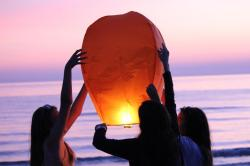 my sister, mother and i setting off a flying lantern