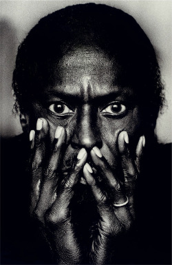 "burnedshoes:  © Anton Corbijn, 1985, Portrait of Miles Davis, Montreal / Canada ""Taken in his hotel room with light falling in from the window. In his very large pupils you can actually make out my silhouette. It was a very brief shoot but one of the most satisfying ever. It is also worth noting that this photo was taken well before the TUTU album shoot by Irving Penn and it has become one of my most well- known photographs."" (Anton Corbijn)"