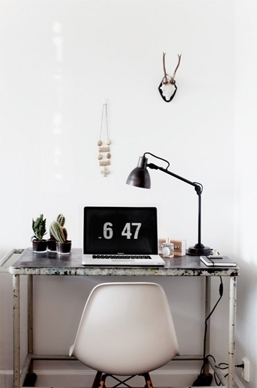 A nice quaint workspace nestled into the corner.