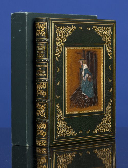 "book-aesthete:  Little Brother & Little Sister Jakob and Wilhelm Grimm. Illustrated by Arthur Rackham. London: Constable & Co., Ltd., 1917. Bound by Bayntun-Riviere c. 1965. One of 525 Copies Signed by the Artist. Limited to 525 copies signed by the artist, this being copy no. 259. Quarto. Thirteen tipped-in color plates, forty-three black and white text illustrations. Bound by Bayntun-Riviere c. 1965 in full midnight green morocco with inlaid pictorial central panel reproducing the color-plate ""She Begged Quite Prettily to be Allowed to Spend the Night There"" (opposite p. 206) in gilt-tooled frame within triple gilt-ruled borders and large, gilt foliate corner-pieces. Gilt rolled edges. Broad, gilt dentelles. Gilt decorated compartments. All edges gilt. - via"