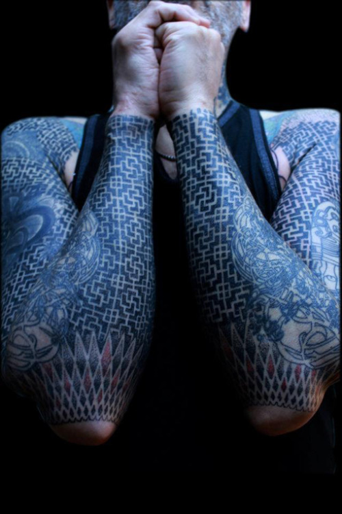 allinayear:  Blackwork swastika pattern on arms. Tattooed by El Patman of ArtCorp Tattoo, Paris, France.  dizzying! skilled!
