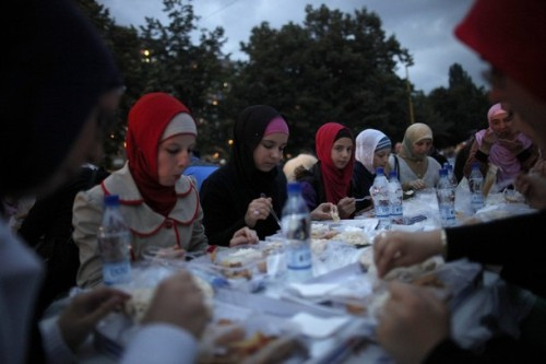 thereligionofpeace:  Bosnian girls and women break their fast at the end of the third day of Islam's holy month of Ramadan in the central Bosnian town of Zenica July 22, 2012. About 2,500 people attended the Ramadan dinner at the main city square. (Reuters)