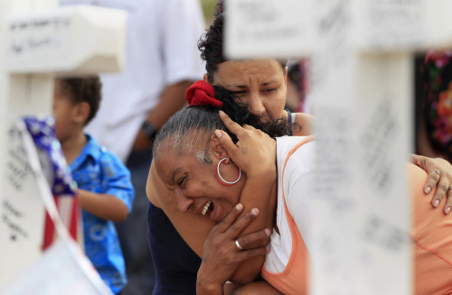 "reuters:  Denise Paba, who lost her 6-year-old niece Veronica Moser, is comforted by a woman as she cries at a memorial for victims behind the theatre where a gunman opened fire last Friday on moviegoers in Aurora, Colorado July 22, 2012.  Residents of a Denver suburb mourned their dead on Sunday from a shooting rampage by a ""demonic"" gunman who killed 12 people and wounded 58 after opening fire at a cinema showing the new Batman movie. President Barack Obama headed to Aurora, on Sunday to meet families grieving their losses Friday's mass shooting that has stunned the nation and rekindled debate about guns and violence in America. REUTERS/Shannon Stapleton"