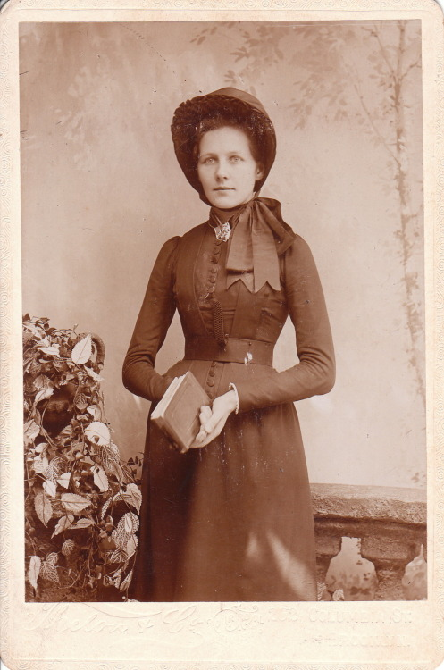 red-phalaenopsis:  A young woman dressed in her Salvation Army uniform poses for her portrait in a Brooklyn, New York photographic studio (262 Columbia Street). The woman appears to be holding a bible and her Salvation Army badge is evident on her collar. The name of the photographer is difficult to interpret but it appears to be Thelou & Co. Research reveals that another photographer, named Leeds, also operated at the Columbia Street address, and that in 1883, the studio was put up for sale.