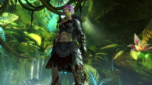 "I submitted a screenshot to the Guild Wars 2 screenshot contest. This is of my character on the beta, ""Fleeting Flash"", a Sylvari Guardian. I think I like how the screenshot turned out. I like how there's still some light that shines through despite the amount of plant life surrounding the image."