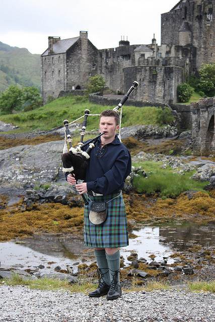 kiltedlife:  Young Piper at Eilean Donan Castle by flambard on Flickr.