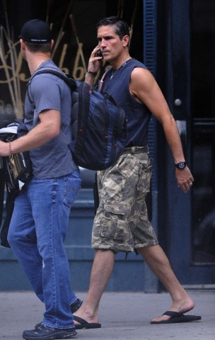 Jim out and about in NYC talking on the phone on Friday. Finally in shorts. (All Rights Reserved by Corbis) 2 of 2
