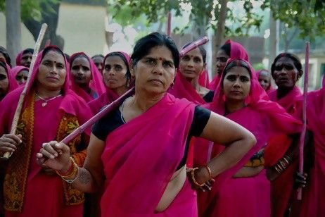 "racialicious:  womentravelmotherindia:  The Gulabi Gang is an extraordinary women's movement formed in 2006 by Sampat Pal Devi in the Banda District of Uttar Pradesh in Northern India. This region is one of the poorest districts in the country and is marked by a deeply patriarchal culture, rigid caste divisions, female illiteracy, domestic violence, child labour, child marraiges and dowry demands. The women's group is popularly known as Gulabi or 'Pink' Gang because the members wear bright pink saris and wield bamboo sticks. Sampat says, ""We are not a gang in the usual sense of the term, we are a gang for justice.""  Fierce is fierce. The end."