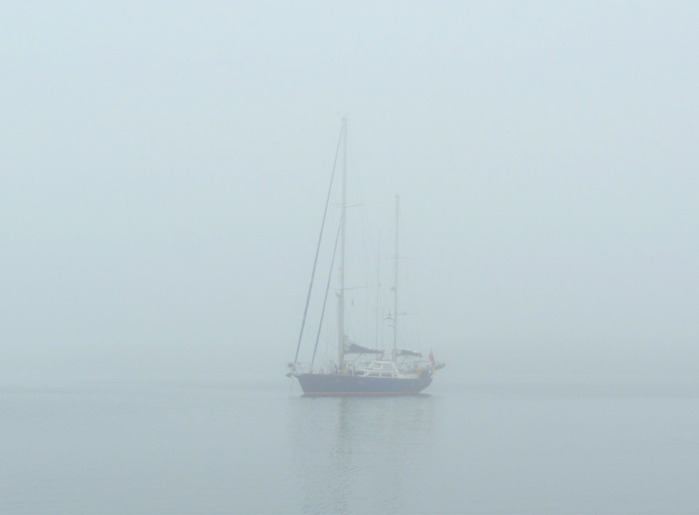 Sailboat in fog—there was quite a bit of it on this trip. It draped the island in a melancholy, ghostly ambiance.