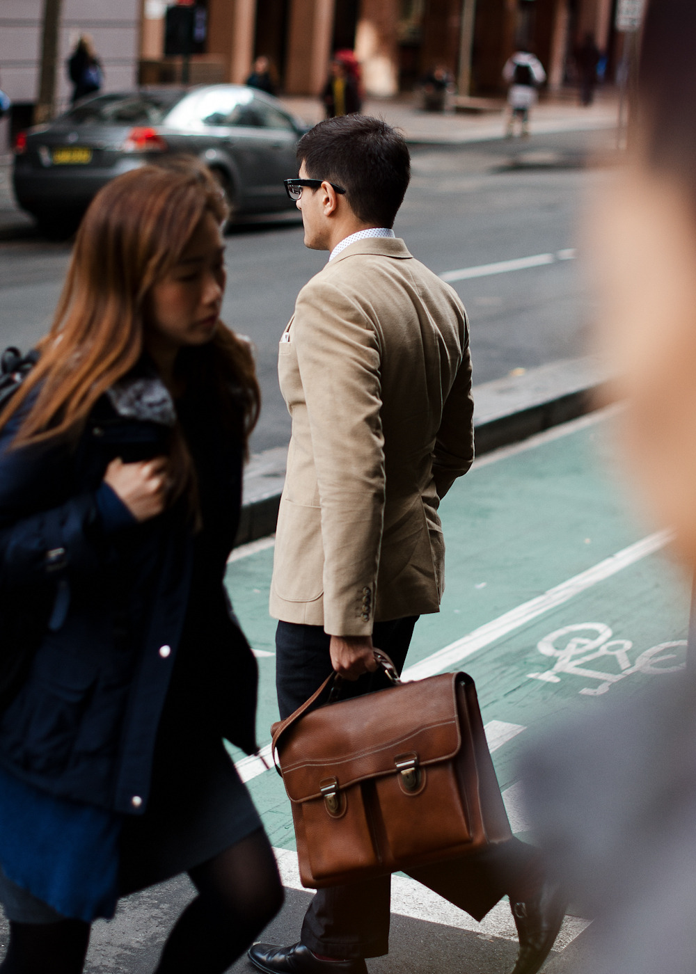 In passing. Similar look: Tan Smooth Leather Class Act Briefcase by Marc by Marc Jacobs.