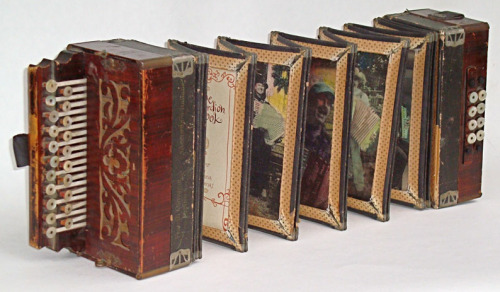 History of the Accordion Book by The Wandering Book Artists uses an actual accordion as the housing of a series of images about accordion players and handwritten text on the players and the accordion.