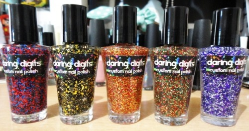 Polishes from Daring Digits at their 20% off sale ♥  From left to right: Spiderman, Batman, Iron Man, Robin, and Punch Me Purple