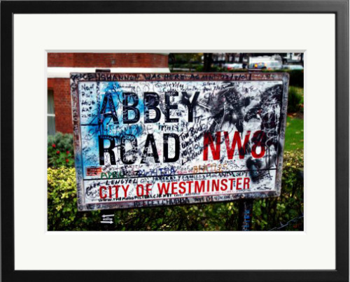 The Abbey Road sign outside Abbey Road recording studios where flowers were laid following the death of George Harrison November 30, 2001 in London.