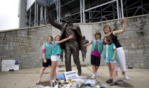 STATE COLLEGE, PA - JULY 21: Annabelle Johns, Maya Mondock, Marissa Mondock, Julia Neumann and Tara Mondock, members of a Girl Scout Troop based in Port Matilda, Pennsylvania pose for a photo with the statue of former Penn State University football coach Joe Paterno stands outside Beaver Stadium July 21, 2012 in State College, Pennsylvania. Penn State's president Rodney Erickson is expected to make a decision on whether or not to remove the statue in the wake of the child sex scandal of former assistant football coach Jerry Sandusky. It's believed that Paterno had detailed knowledge of Jerry Sandusky sexually abusing children before and after Sandusky retired from coaching at Penn State. (Photo by Jeff Swensen/Getty Images)  This is a disturbing picture in my opinion. This man was involved in the cover up a child molester for more than a decade. However small or large his role was is not relevant. He knew about it and did nothing to stop it. For this woman to take these young girls to have their photo taken with Joe Paterno's statue is baffling. Do these Girl Scouts even know what this man did? Did they know why officials at Penn State eventually removed the statue? This man did a lot of good in his life, make no mistake, but in my eyes, all of that is negated by his involvement with the cover up of Jerry Sandusky's systematic sexual abuse of young boys for more than a decade. He and his legacy have lost the right to be a role model. And I would have serious reservations about the moral standing of anyone who still sees him as a role model.