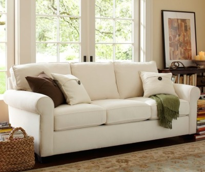 "Oh hey! I forgot to show you guys a pic of the sofa we ordered! Here it is, above. It's from Pottery Barn, it's a sleeper sofa (which is why it won't arrive until mid-September - I'm told sleepers take a lot longer to make), and we ordered it in ""Caramel Twill"" which is basically like a dark tan color.  So excited! Our living room still has a long way to go before it's even functional, let alone perfect. But we're saving up and paying cash for everything, so naturally it's a process. Baby steps, right? At least we won't be sitting on the floor anymore. [image courtesy of Pottery Barn, of course]"