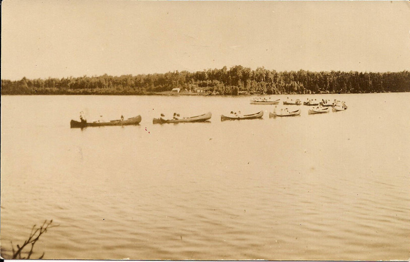 Canoe group from Camp Idyle Wyld, Oneida County, Wisconsin. When farming began to wane in Northwoods Wisconsin in the early- to mid-twentieth century, camps and resorts became a major component of the local economy. Located on the largest chain of inland lakes in the world, the community of Three Lakes drew visitors from around the country who came to relax, fish and play golf. Children, too, came from around the country to attend the large number of summer camps the area had to offer. This postcard depicts campers from Camp Idyle Wyld canoeing on Townline Lake, one of the twenty-eight lakes which make up the Three Lakes Chain. Camp Idyle Wyld was founded in 1916 and was the first girls' camp in the state. In Wisconsin's Northwoods today, the visitor population has shifted from campers and resort-goers to retirees and short-term tourists. Camps are still popular but have decreased significantly, as have resorts. Instead of renting cabins, tourists are more likely to purchase lake homes or condos and come up mainly on the weekends, while many homes in the area are owned by retirees.  via: Three Lakes Historical Society This week's blog is curated by Breanna Norton. Breanna grew up in the Northwoods and has lived, worked and studied in Wisconsin most of her life. She completed her undergraduate degree at UW-Madison in Anthropology, Archaeology and Material Culture and is currently searching for that perfect museum job.