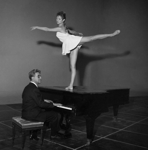 Brigitte Bardot dancing on a piano