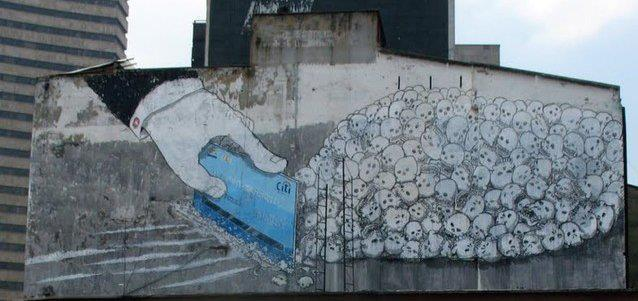 streetartglobal:  By Blu in Bogota - a Citi credit card used to chop skulls into lines of cocaine. Do you think Blu's suggesting major banks have supported the narcotics industry by laundering money? I wonder!