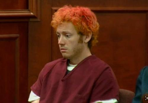 The first photos are coming out of the Colorado courtroom where 'Dark Knight' shooting suspect James Holmes appeared before a judge this morning. His hair was orange, he was wearing a jump suit, and he appeared dazed.