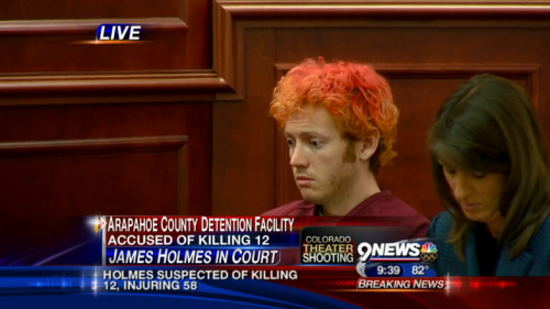 Colorado shooting suspect James Holmes, with dyed reddish-orange hair, appeared dazed and somber today during a court appearance to be told that he is being held on suspicion of first-degree murder. More: http://usat.ly/LJbenI