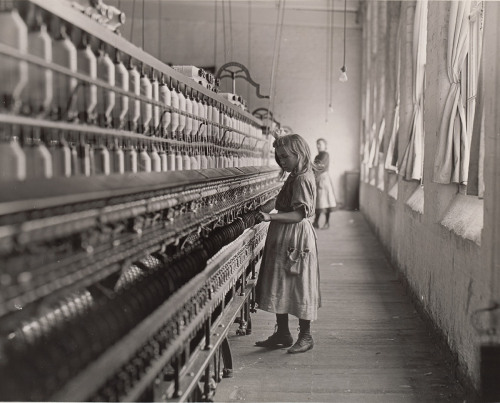 Lewis Hine. Child in Carolina Cotton Mill. 1908 American photographer and sociologist Hine recorded children's working lives on behalf of the National Child Labor Committee, an organization established in 1904 to alleviate the exploitation of children, with headquarters in New York. A source of cheap labor then as now, children in factories and sweatshops assisted in the process of churning out goods designed for markets that included their middle-class peers. Learn more at MoMA.org/centuryofthechild