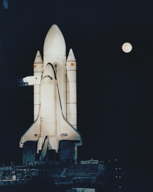 "scanzen:  The Space Shuttle ""Enterprise"" stands on Kenndey Space Center Pad 39A highlighted against the darkened Florida sky during testing of the high-intensity lighting system. The banks of xenon lights are used during lanuch preparations. (2/6/1980)photo: KSC/NASA via archive.org"